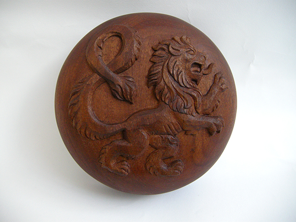 Heraldic carving detail on paper weight