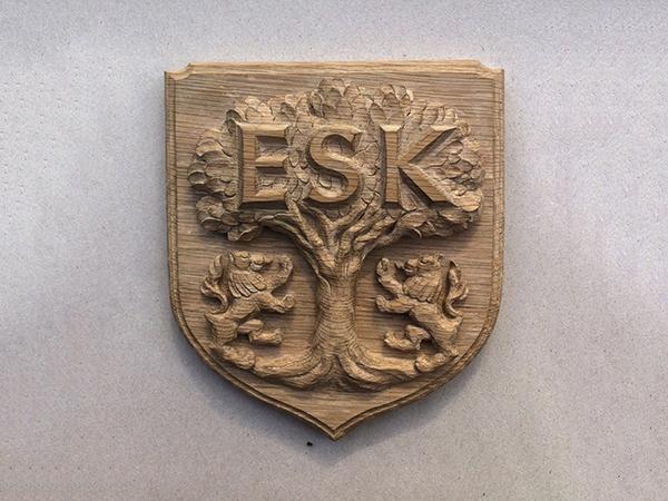 Carved heraldic shield - ESK school