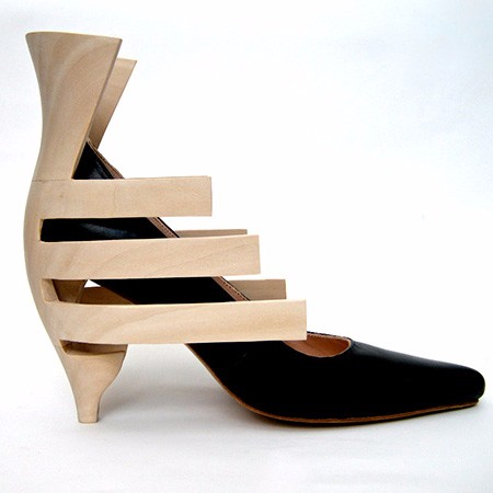 Carved scluptural heel wood