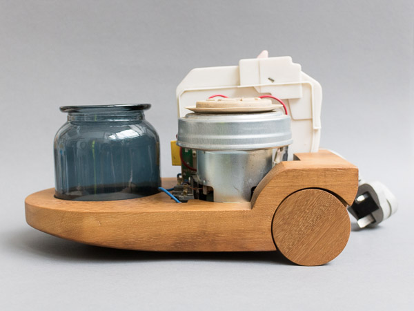 Contemporary craft - Vacuum Cleaner base carved in recycled teak