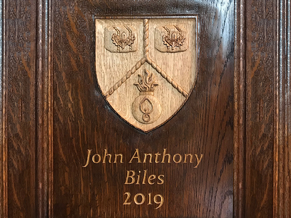 2019 Master's Coat of Arms - Carved in situ on oak panelling