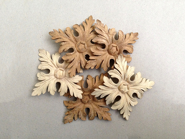 Decorative ornaments - Carved wooden rosettes