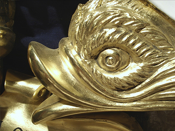 Carved and gilt heraldic dolphin